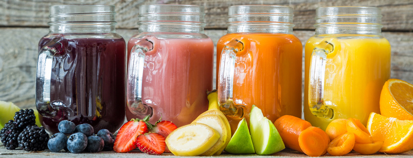 Slection of fresh fruit juices in jars, copy space