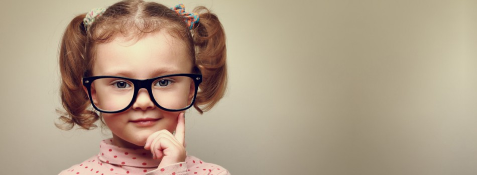 Thinking little kid girl looking happy in glasses. Vintage portrait
