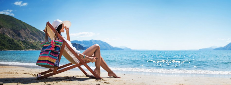 Woman enjoying sunbathing at beach. Summer vacation